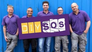 The DIY SOS team holding up a sign